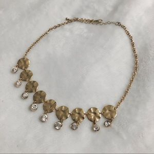 A gold and fake diamond necklace